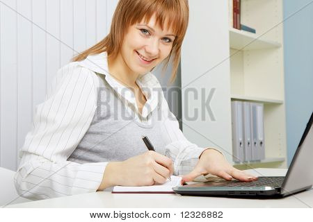 Attractive Young Woman With A Laptop