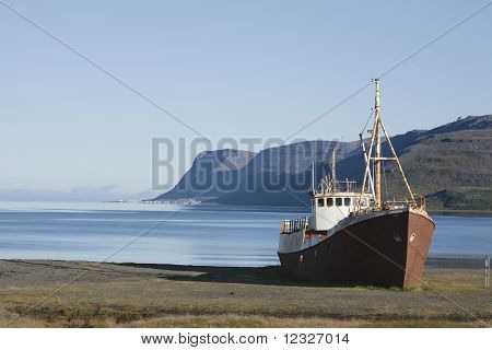 Shipwreck shore beach trawler in Westfjords Iceland