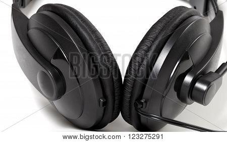 Black headphones isolated on white background .