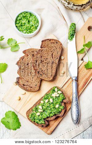 vegan cilantro pine nuts pesto on a white wooden background