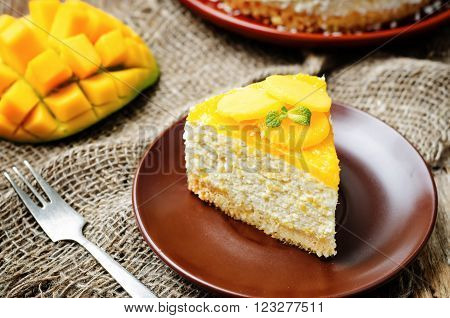 creamy mango mousse cake on a dark background