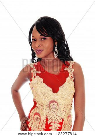 A gorgeous African American woman standing in a red evening dress with gold embroideries and long black hair isolated for white background.