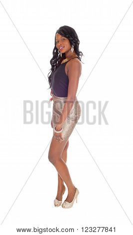 A beautiful African American woman is a gold color skirt and black blouse