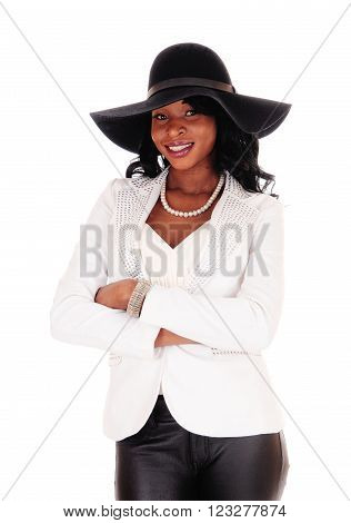A beautiful African American woman in a white jacket and black tights
