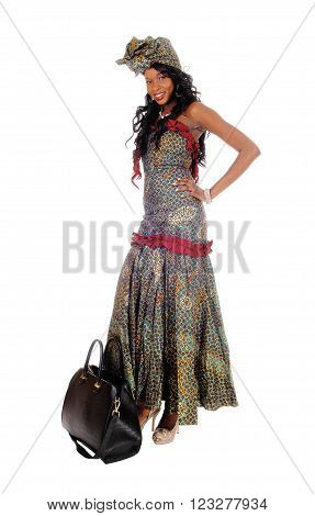 A beautiful African American woman standing in an long African dress and black hair and with purse isolated for white background.