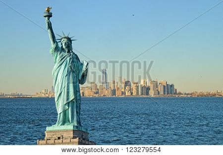 Manhattan Island and Statue of Liberty at sunny day.