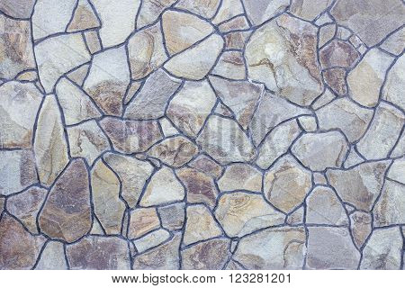 Stone cladding on a fence as a textured background