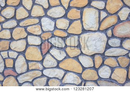 Pebble coating of a fence as a textured background