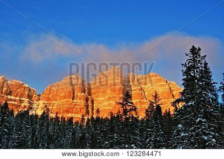 Breccia Peak and Cliffs on Togwotee Pass near Dubois and Jackson Wyoming USA at wispy cloudy alpenglow sunset