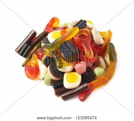 Pile of multiple colorful gelatin and licorice based candies isolated over the white background