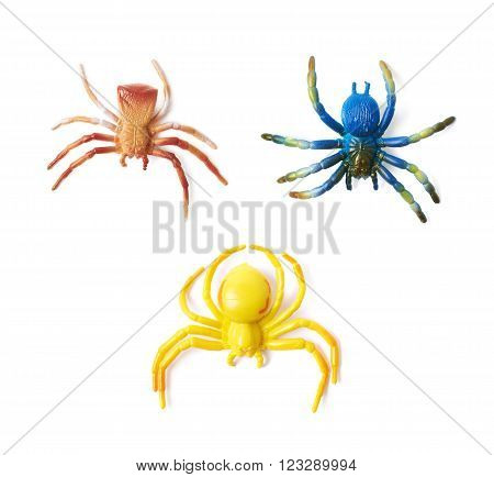 Fake rubber spider toy isolated over the white background, set of three different foreshortenings