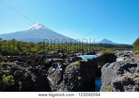 The waterfalls close to Puerto Varas: Saltos del Petrohue with the vulcano Osorno in the background