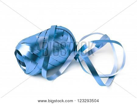Glossy ribbon reel partly unwrapped, composition isolated over the white background