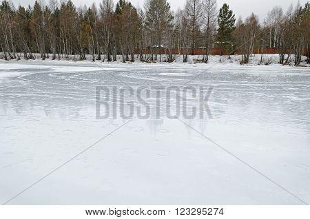 Irkutsk Region, Russia -March,20 2016: Icebound river on a cloudy spring day in the village. Kochergat Irkutsk Region Russia
