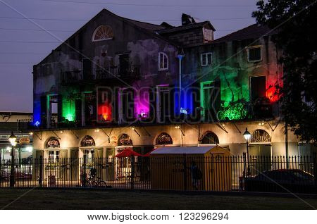 New Orleans, USA - July 13, 2015: Multicolored lights building with Louisiana Pizza Kitchen restaurant in French Quarter, New Orleans.