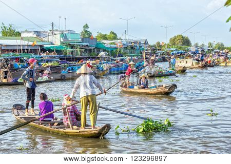 Soc Trang, Vietnam - February 2nd, 2016: Ferry women take visitors sailing across the river and down, crowded on the river to reach the festival days in rural areas of Soc Trang, Vietnam