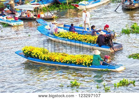 Soc Trang, Vietnam - February 3rd, 2016: Two boats flower exchange trade on river in the morning with the boat loaded with daisies which only sell flowers on Tet new floating market Soc Trang, Vietnam