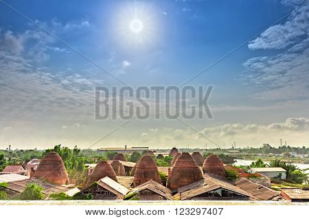 Early sun on the roof of the brick kilns in the countryside with the sun radiating star shines down brickyard panoramic beautiful villages and idyllic in Vietnam