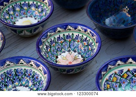 Rows of cups with traditional uzbekistan ornament on a street market of Bukhara Uzbekistan Central Asia. Silk Road ** Note: Shallow depth of field