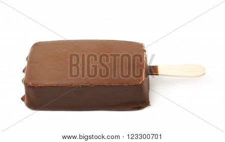 Vanilla ice cream bar coated with chocolate glaze on a wooden stick, composition isolated over the white background