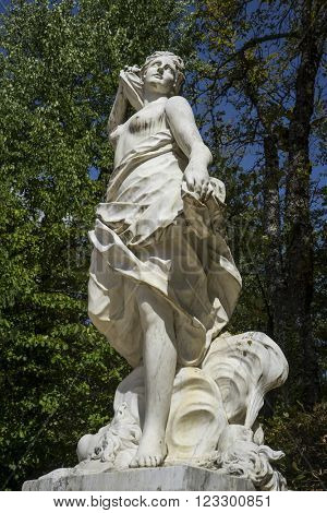 white marble sculptures in the gardens of Segovia, Spain. beautiful figures of classical gods, mythology