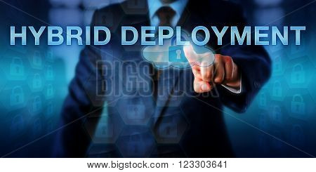 Enterprise strategist is pushing HYBRID DEPLOYMENT on a touch screen interface. Information technology concept and business strategy for moving IT into the cloud and keeping part of it on premise.