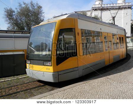 LISBON, PORTUGAL - MARCH 17TH. Modern Yellw Lisbon tram at turning point in Lisbon square. Lisbon Portugal March 17th 2016