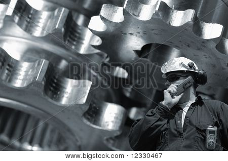 industry-worker and steel gears