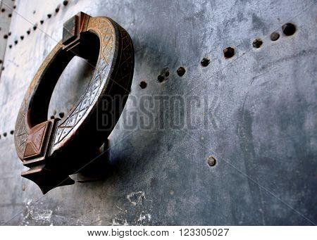 large door knocker on a steel door