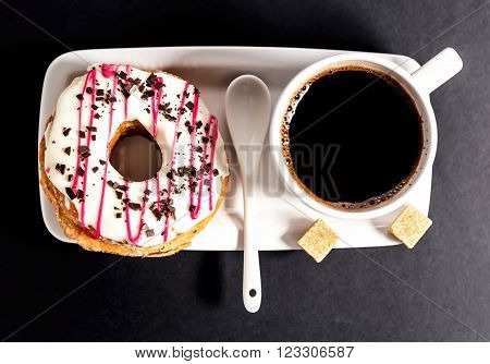 Donut and cup of coffee .Top view