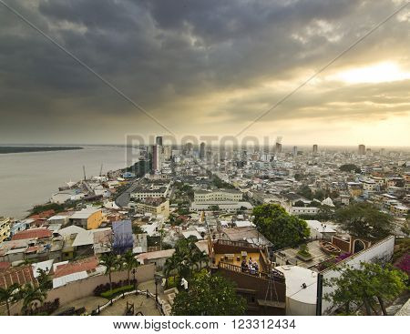 view on ecuador city Guayaquil from hill at sunset with clouds on sky