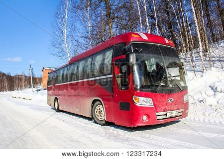 ASHA, RUSSIA - FEBRUARY 21, 2016: Red intercity coach Kia Granbird at the countryside.