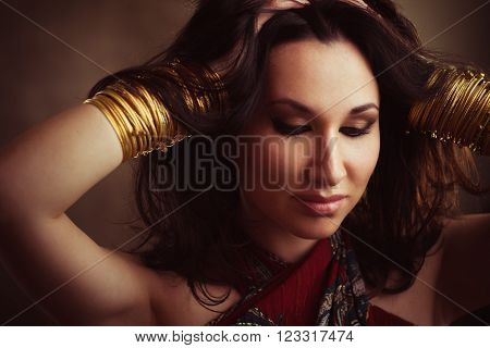 Indian woman with gold bracelets on hands. Traditional east accessories on  indian woman. Foto of indian girl in east style.
