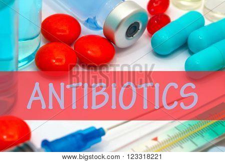 antibiotics. Vaccine to treat disease. Syringe and vaccine with drugs.