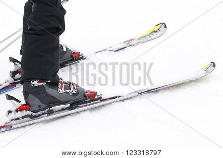 a foot closeup skier, winter sports background