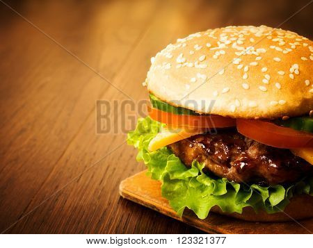 Juicy Burger On A Wooden Board