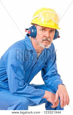 Tired adult worker has a rest sitting over white background