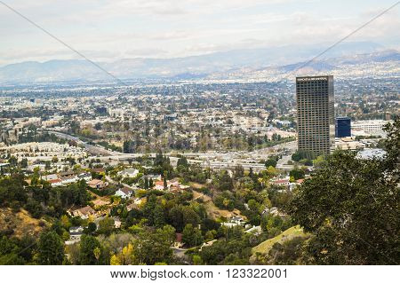 Los Angeles, CA, USA . January 16, 2016: View of the los angele. Good sunny day in downtown Los Angeles, California. Aerial view of Los angeles city from Runyon Canyon park Mountain View