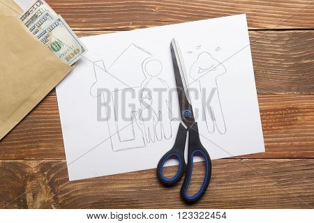 Family law concept. Divorce section of the property by legal means. Scissors cutting paper.