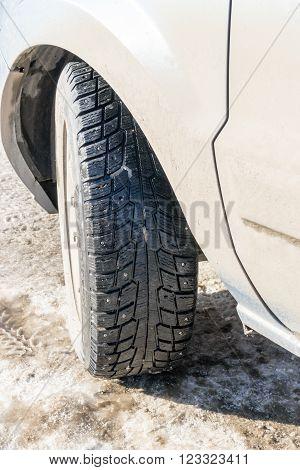 Winter Tire On A Grey Car In Sunlight