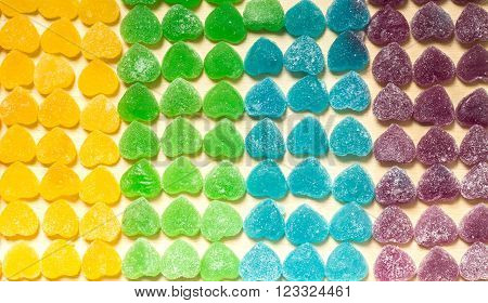 Colorful Jellies And Candies Sweets Heart-shaped On Wood Background