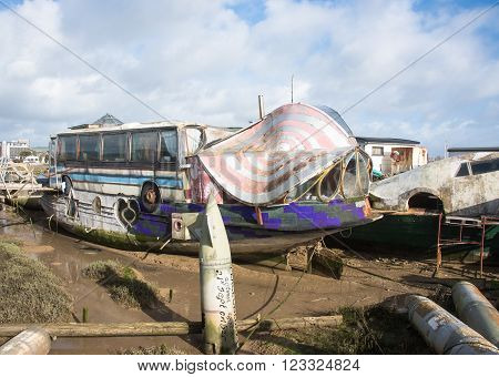 Shoreham-on-Sea, UK - February 6 2016 : Old barge converted into a house boat with part of a bus in the design.