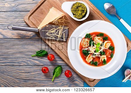 tortellini soup with italian sausages spinach tomato parmesan cheese pesto-sauce