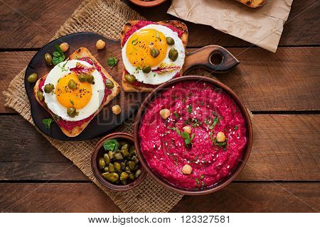 Diet Sandwiches With Beet Root Hummus, Capers And Egg. Top View