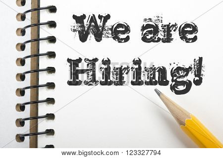 We are Hiring. Notpad and pencil. Top view