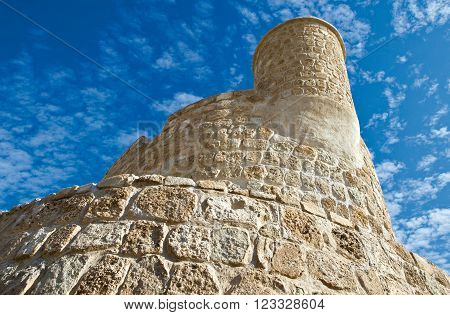 Manama, Bahrain - December 13, 2006: Upward view of the Portuguese fort of the XVI century also known as Bahrain Fort.