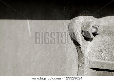 screw with nut on a old railway car at the port of Magdeburg