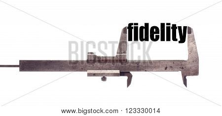 Color horizontal shot of a caliper and measuring the word