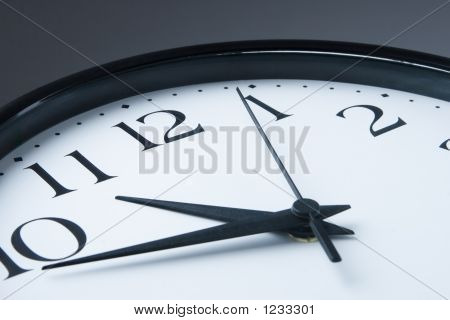 White Clock With Black Border On Gray Background