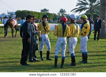 Manama, Bahrain - January 12 2007: Local people and jockeys in the Equestrian and Horse Racing Club.